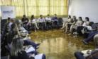 Reunião apresentou logo do comitê (banner ao fundo)
